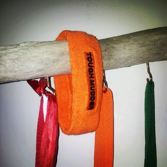Tough Mudder headband on the medal rack