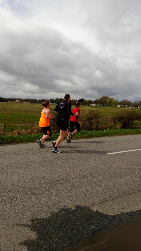Me (luminous orange) and Ronnie (black) at around the 6 mile mark.  Photo: Nichola Ritchie