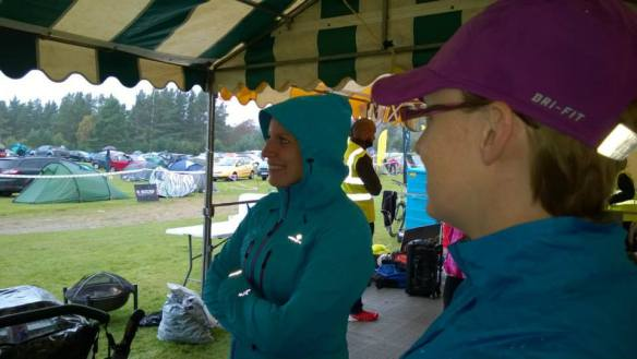 Taking shelter and looking enthusiastic about running for 12 hours in rain.